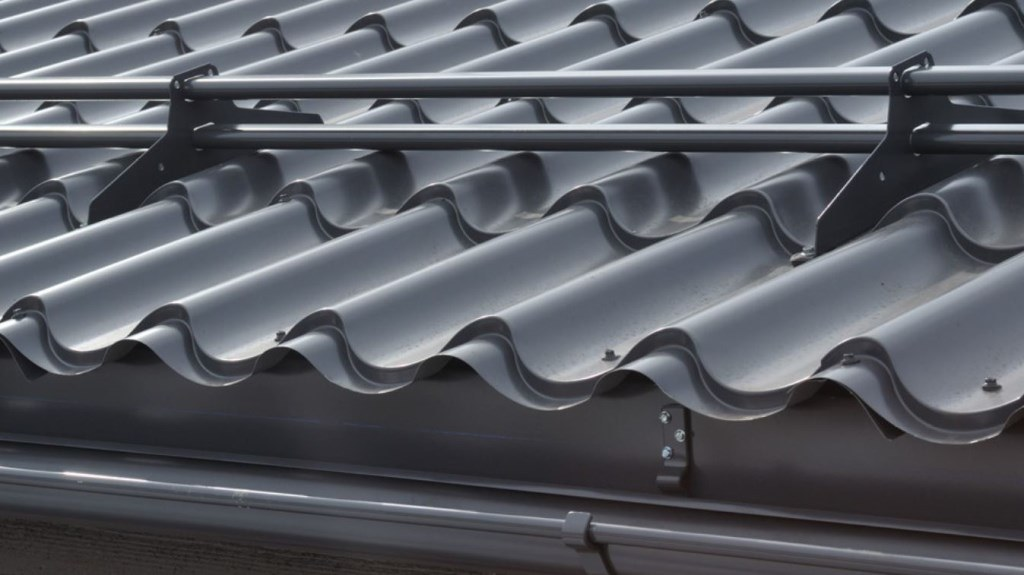 Metal tile roof snow guards