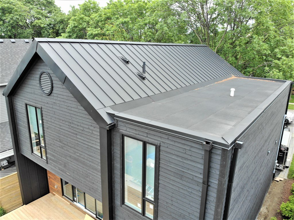 Standing Seam Metal Roof And Fa 231 Ade And Flat Roof With