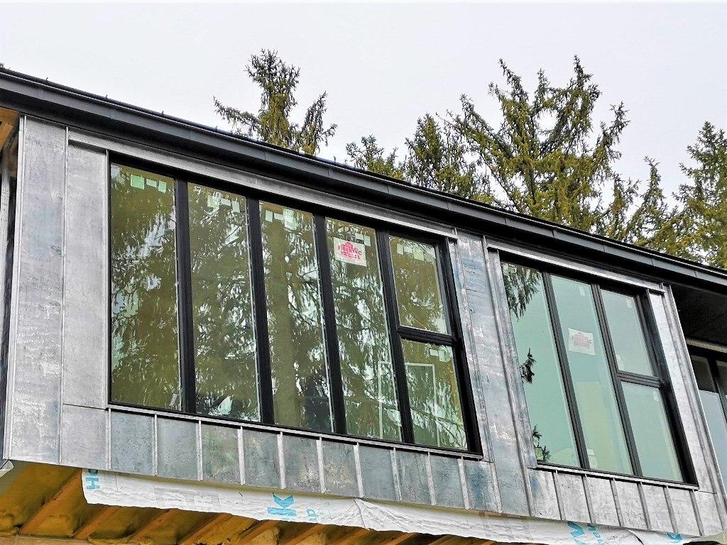 Tinned coper standing seam façade.