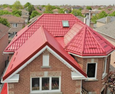 Metal tile roof project. Main Street and Queen Street.