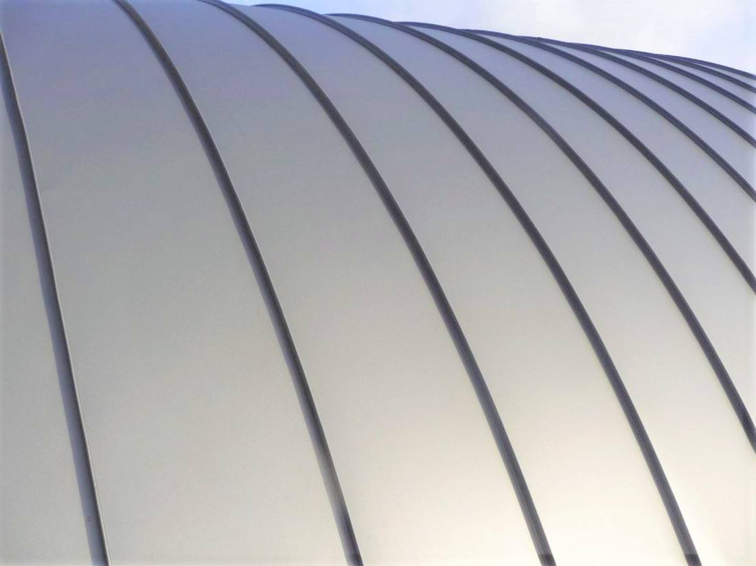 Curved standing seam metal roof
