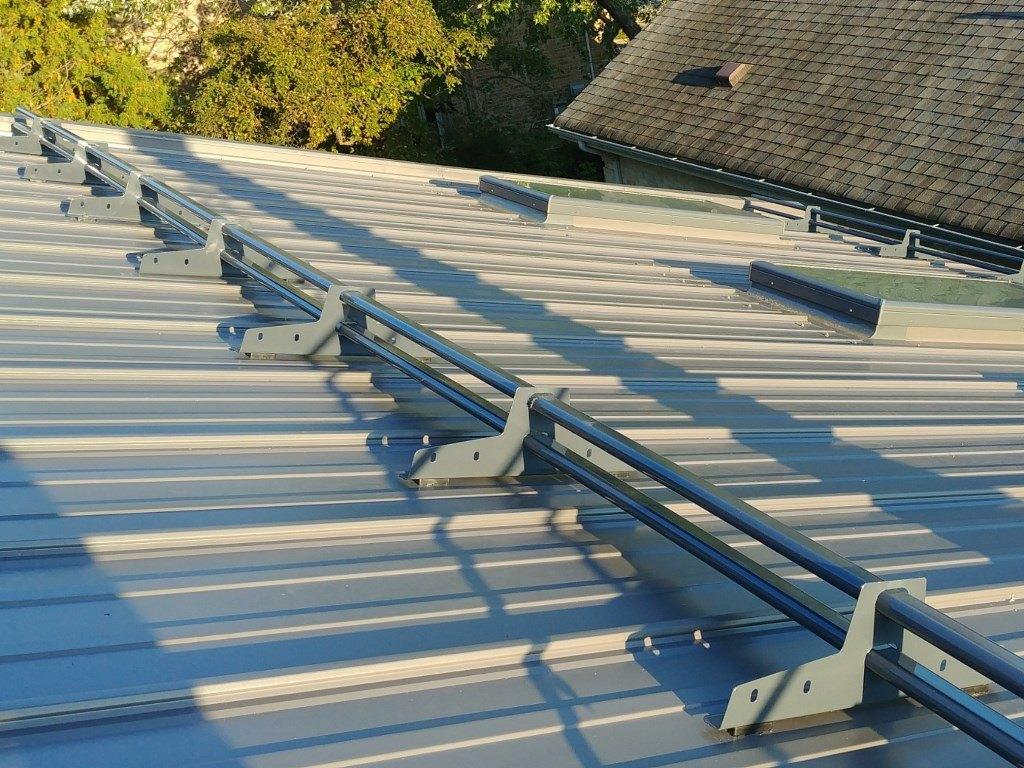 Snow guards on straight rib panels metal roof