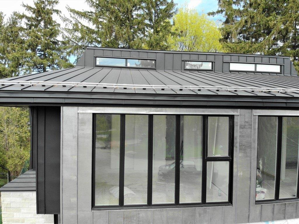 Standing seam metal facade