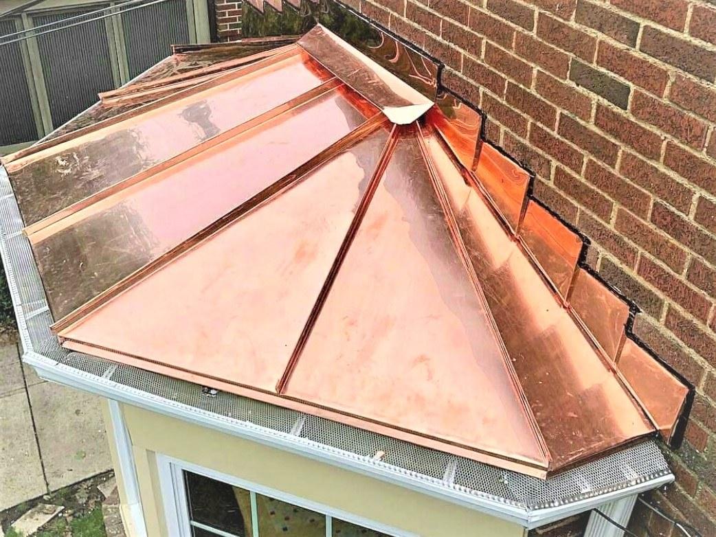 Copper bay window standing seam roof