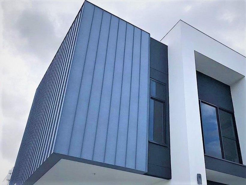 Metal siding on façade