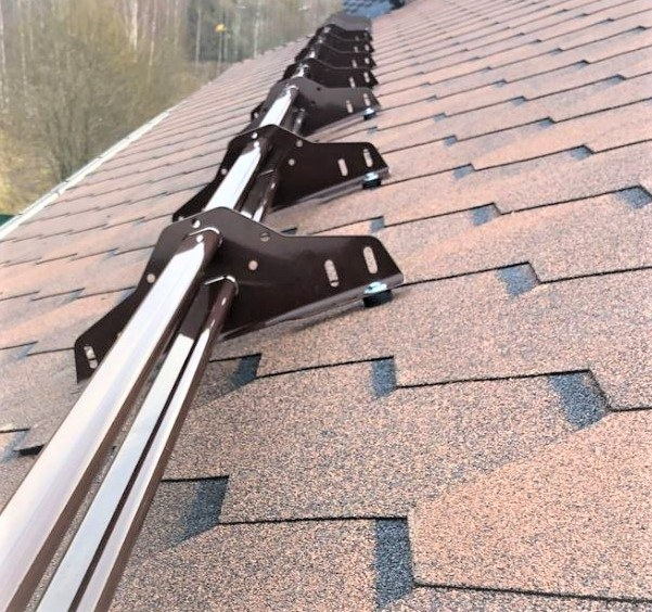Snow guards for shingle roofs