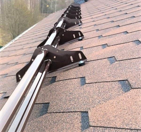 Tubular snow guards for shingle roof