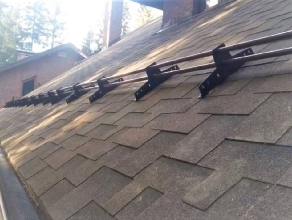 Snow guards on shingles roofs