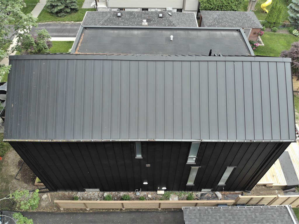 Black standing seam metal roof and facade