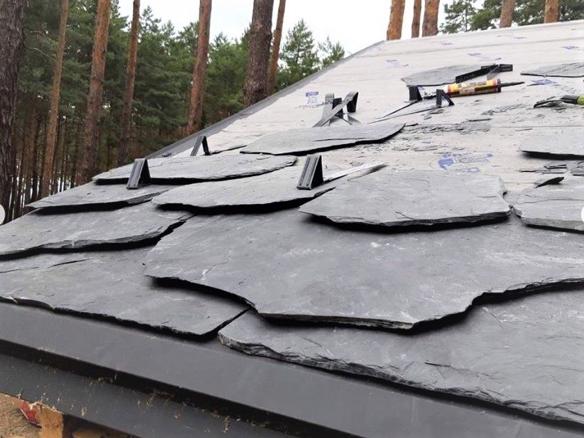 Snow guards installation on slate roof