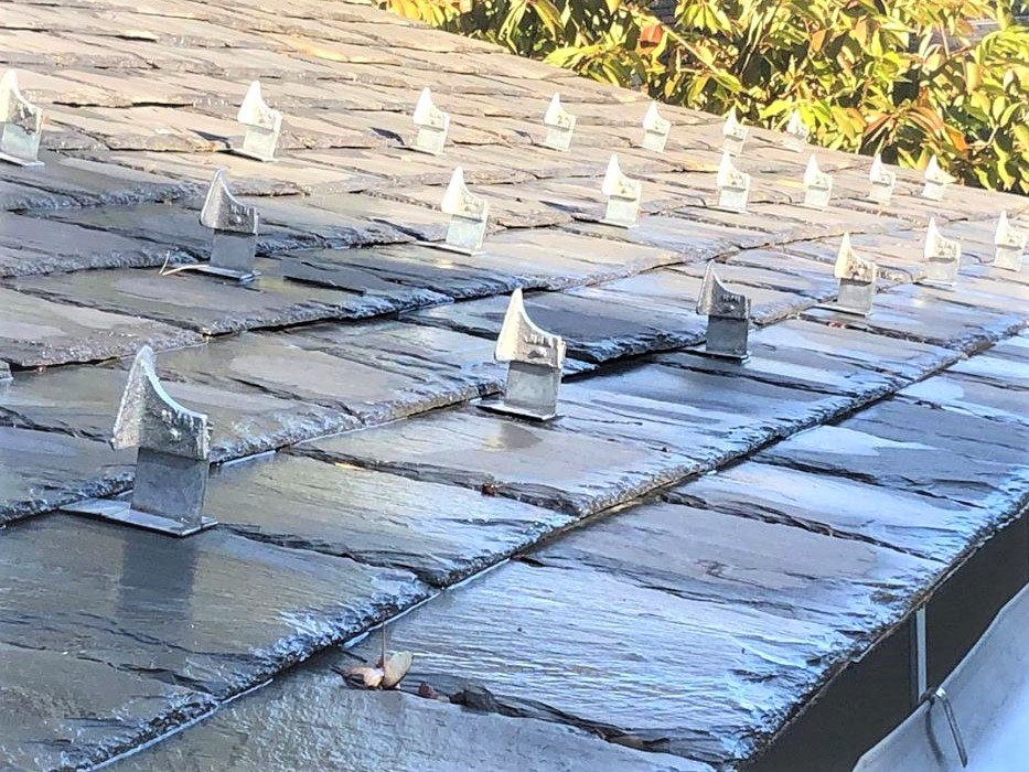 Stainless snow guards on slate roof