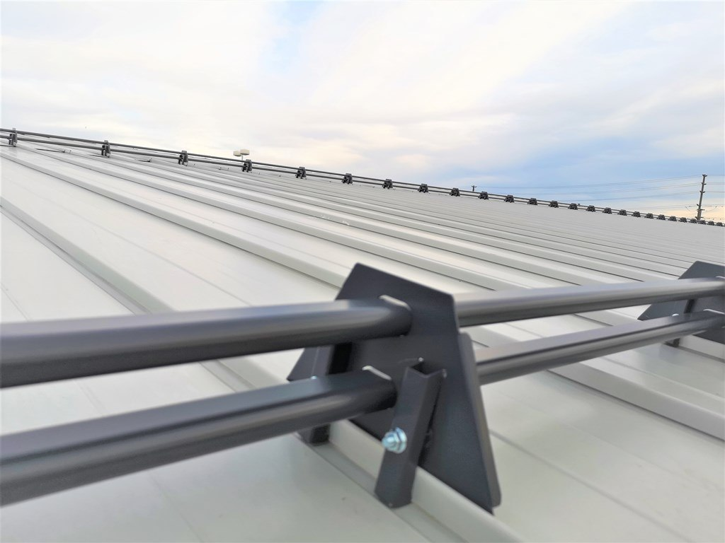 Steel snowguards on standing seam metal roof