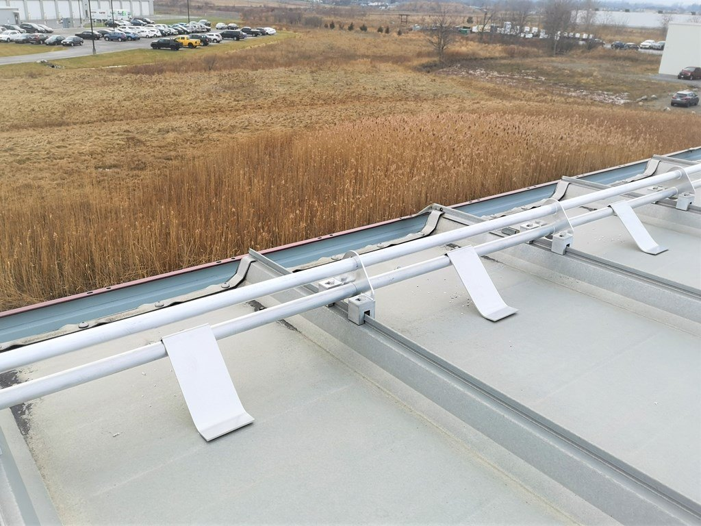 Aluminum tubular snowguards on metal roof