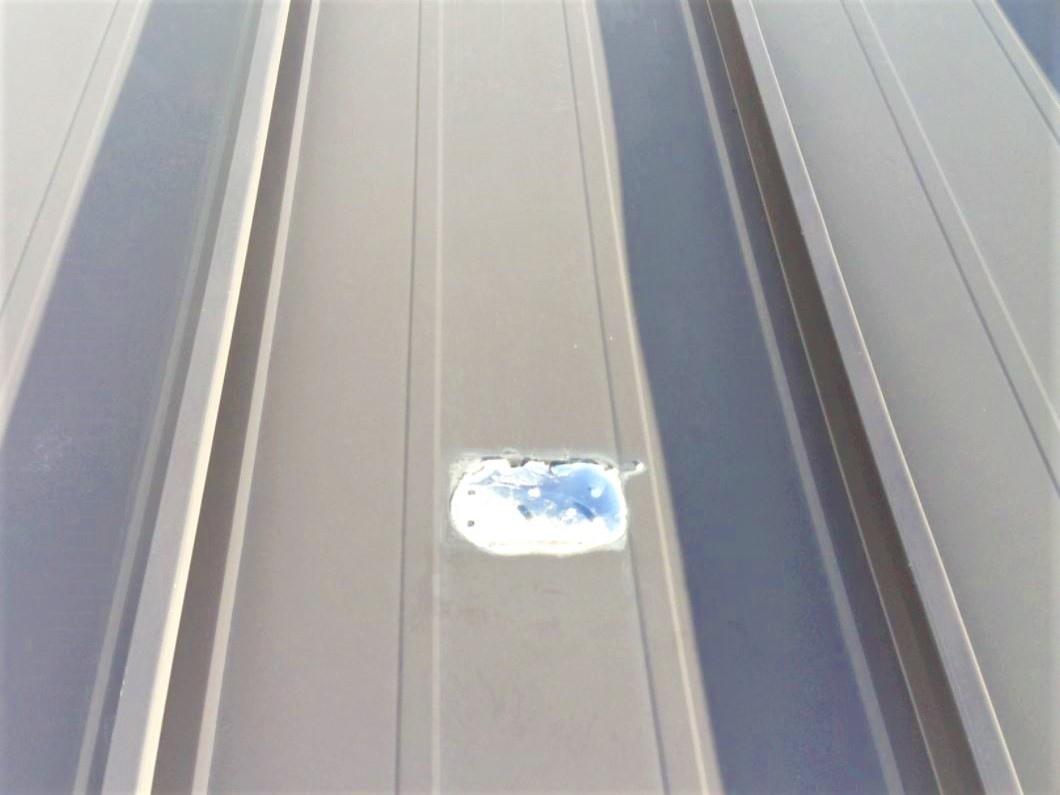 Broken plastic polycarbonate snow guards on metal roof